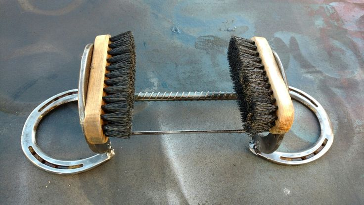 Boot cleaning and scraping center made from original Fuller brushes and up cycled horseshoes