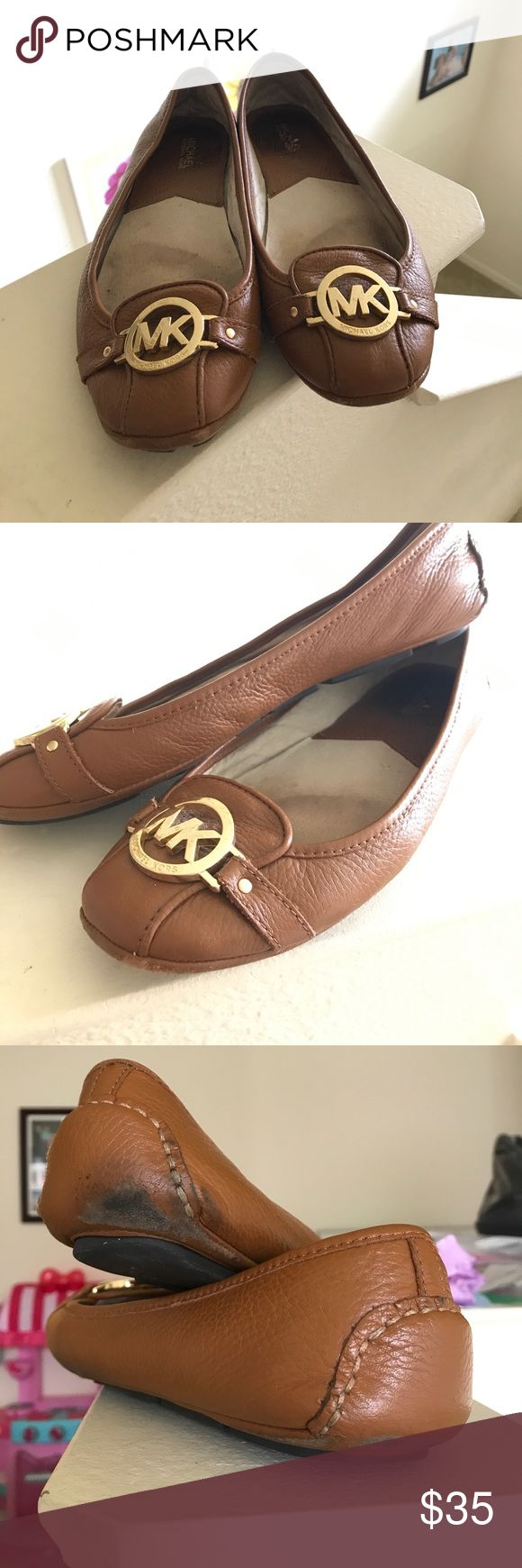 Michael Kors brown ballet logo flats These flats are a staple item in my closet. I've lost some weight and my shoe size has gone down. There is wear and tear on these shoes so please look at the pictures. I am willing to negotiate reasonable offers. Originally bought at Neiman Marcus for $99. Michael Kors Shoes Flats & Loafers
