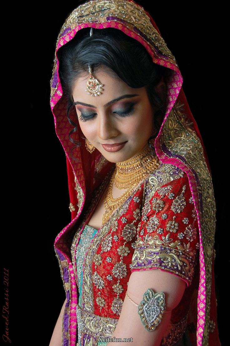Indian woman wearing an intricately beaded dress