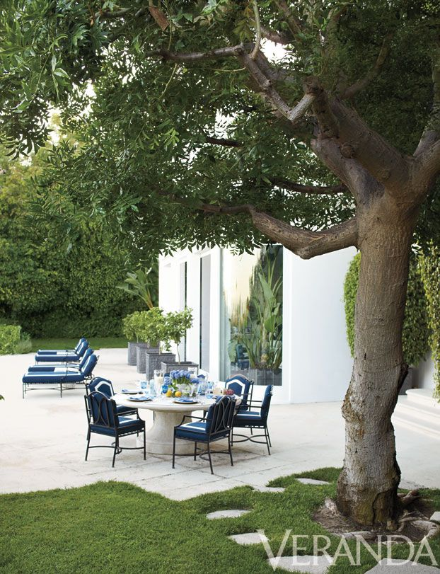 We're obsessed with the blue and white fabric on these outdoor dining and lounge chairs!