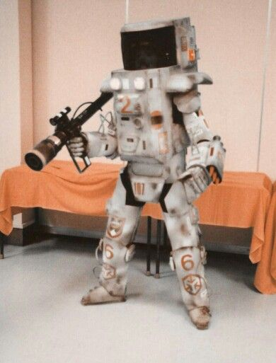 Me wearing an armoured combat suit based on a design dictated by the limitations of the construction materials. (foamcore board, vinyl placemat material and masking tape)