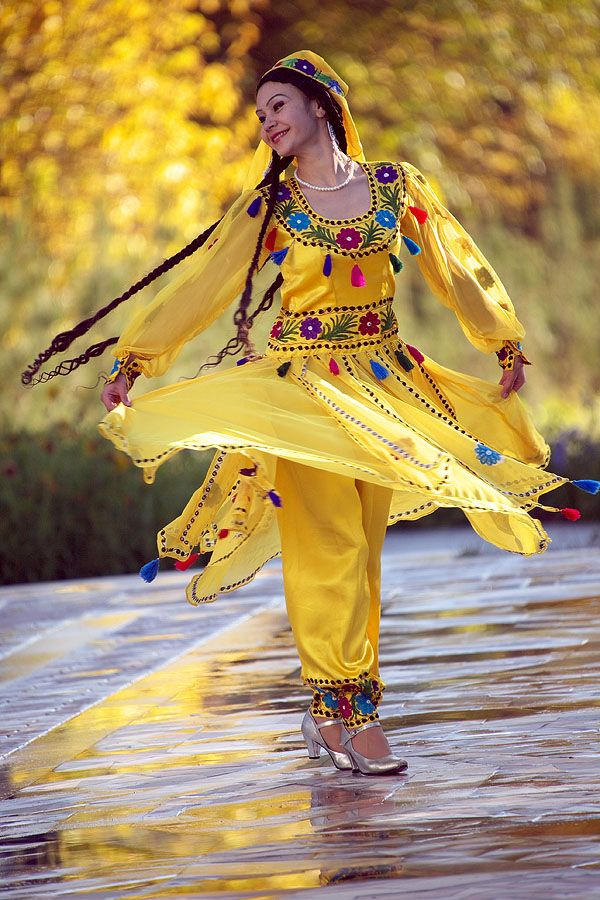 Tajikistan - on the way to an open society (lovely picture. is she a dancer, I wonder?)