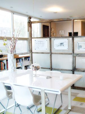 an old garage door serves as a screen separating the space