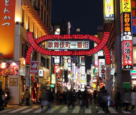 """Kabukichō, Tokyo, Japan, one of the 'top 10 red-light districts in the world' b Kabukichō is an entertainment area as well as one of the few large red-light districts in Japan. Located in Shinjuku, Tokyo, Kabukichō is lined with restaurants, bars, nightclubs, cinemas, sex shops, love hotels and massage parlors. Known as a """"sleepless street,"""" . Different from in the red-light district in Amsterdam, there are no red lights with prostitutes in the windows here."""