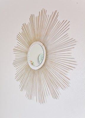 This DIY Sunburst mirror design is my favorite but I can't decide which color would look good against a hot chocolate colored wall. Black, white, gold?