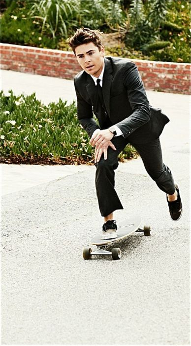 OK, no joke, this is seriously want I want to pull off: skateboarding in a suit. How often do you see a guy rolling down Boylston St. in a suit? Yeah, didn't think so. My only question is how to work the shoes so they're functional here, but also don't look like skater shoes.