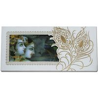 Really enchanting cream hard bound card has nice Radha-Krishna digital 3D paste up on front panel laterally with feather design, along with cute inserts and envelope too. It's magnificent..!