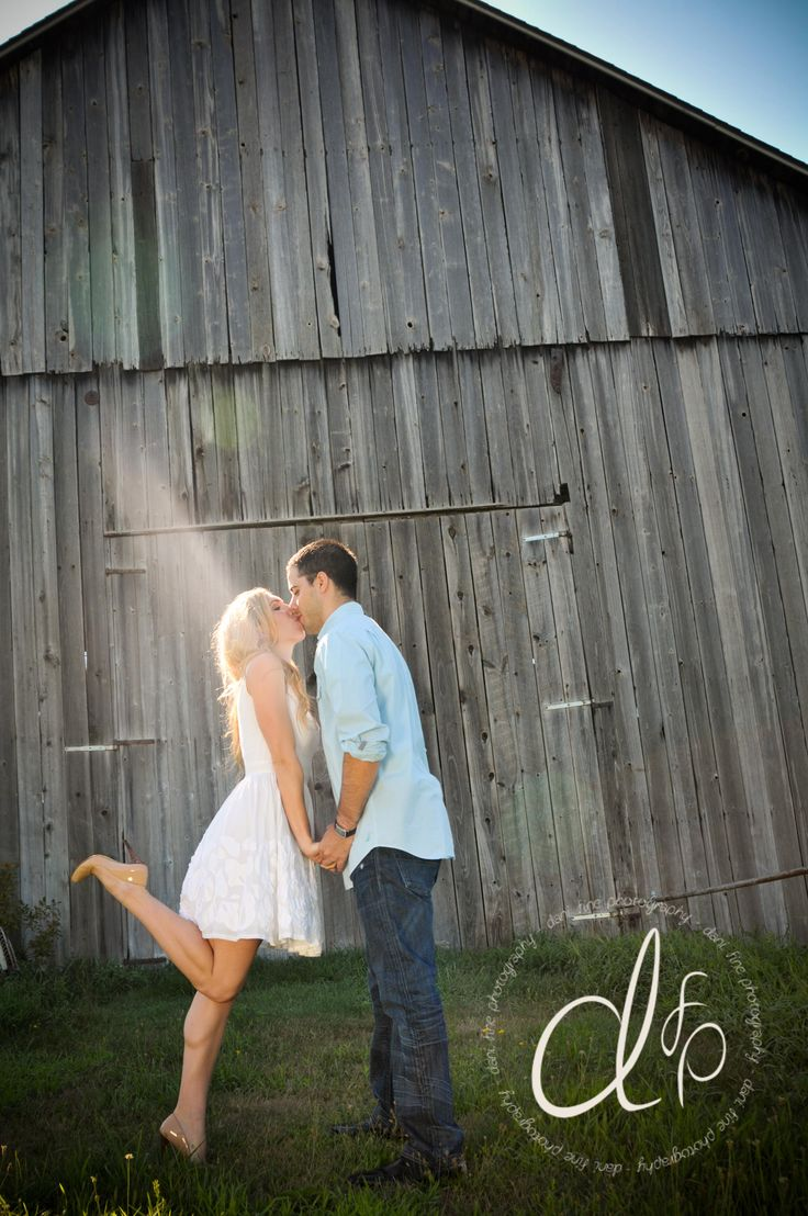 Rustic barn engagement photo shoot complete with bare feet and the perfect kiss with a foot kick! #whitedress #engagement #rustic #weddinginspiration