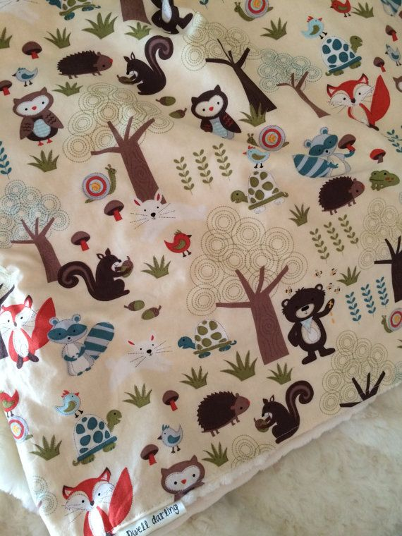 This woodland themed baby blanket is great to spread out on the ground for your baby for floor activities. The animal side is a soft cotton and the