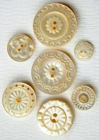 Seven carved antique mother of pearl buttons.
