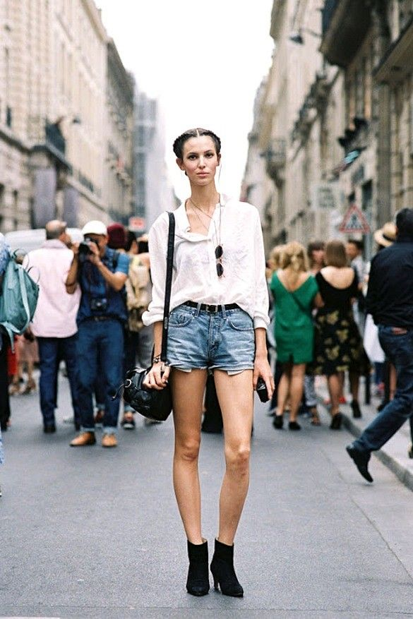 Ruby Aldridge // double crown braids, white button down shirt, leather bag, cut off denim shorts & ankle boots