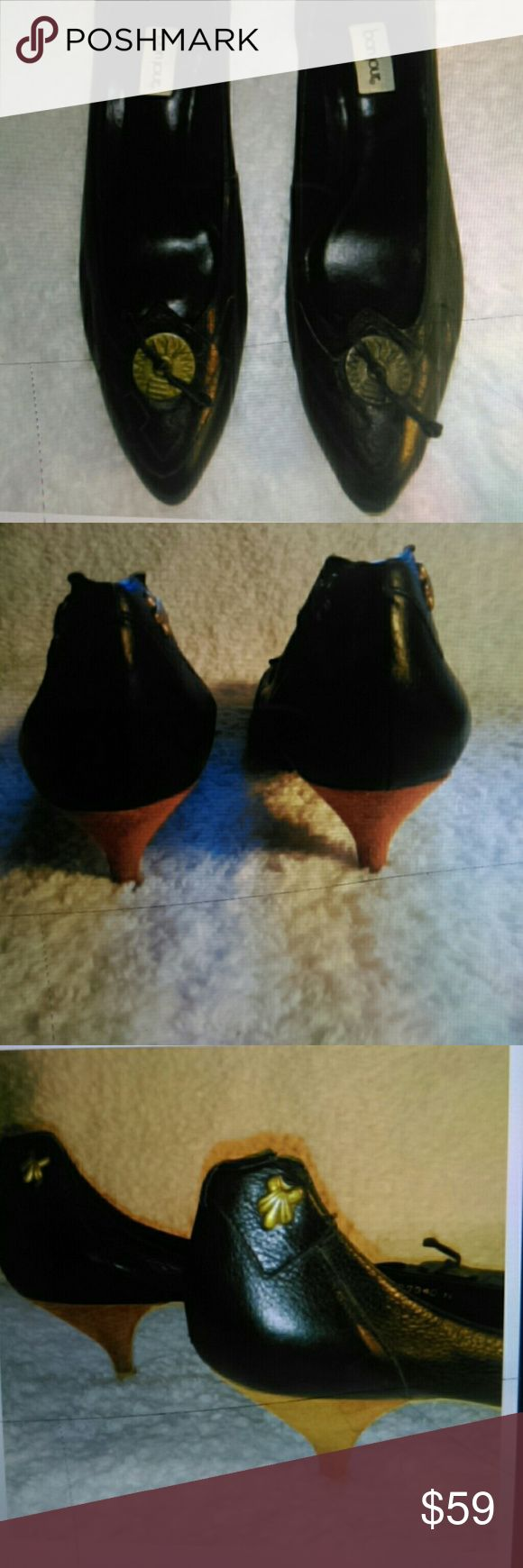 """Bonjour Genuine Black Leather Low 2"""" Low Heel  11 Black Leather low """"kitten"""" heeled pumps by Bonjour. Size 11 Medium Width. (These would not be for wide width feet.) The conch deco on the front of each toe lend a bit of a cowboy/western vibe.  This gives you a feminine alternative to traditional cowboy boots.  Look amazing with jeans, capris, shorts/daisy dukes and cute with skirts & dresses too  Worn a couple of times and have been carefully stored in the closet in a shoebox. Bonjour Shoes…"""