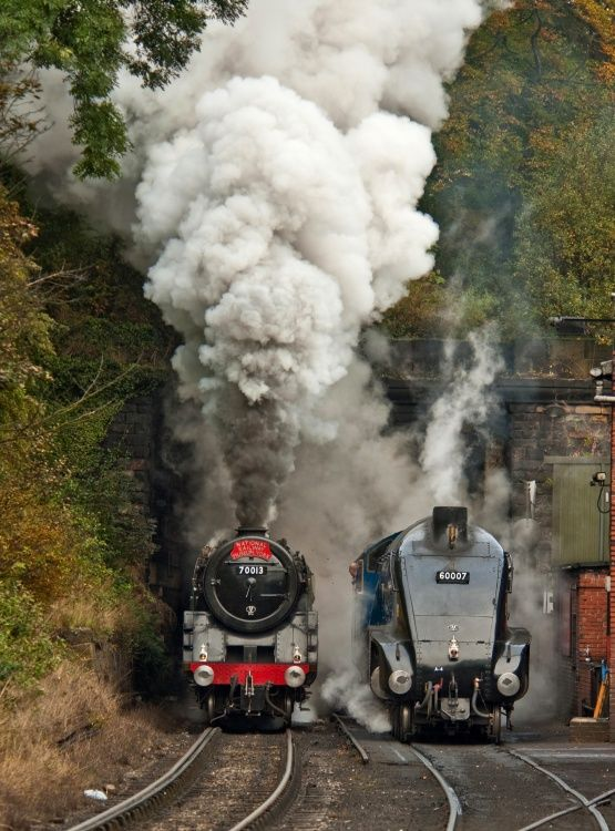 BR Standard Class 7 No. 70013 Oliver Cromwell powers past A4 No. 60007 Sir Nigel Gresley at Grosmont water tower, Yorkshire, England on Friday 2nd October 2009....