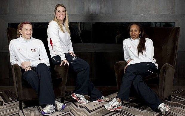 England's Jo Harten and Pamela Cookey with coach Anna Mayes are bidding for netball to be included in the 2020 Olympics.