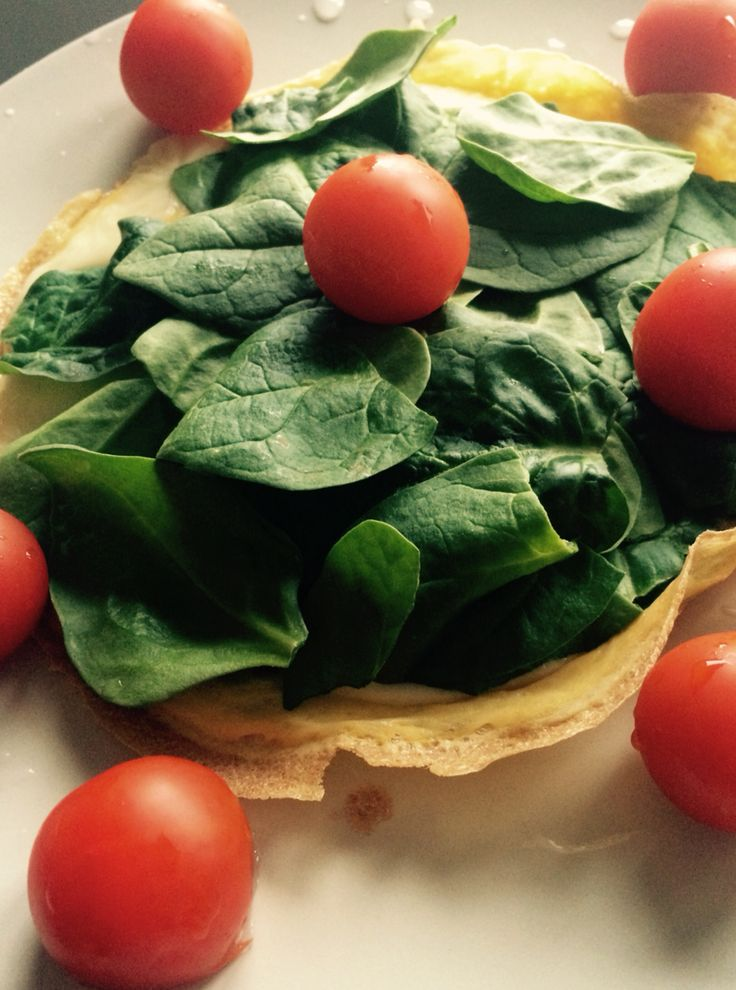 Egg omelet with spinach, cheese and tomatoes