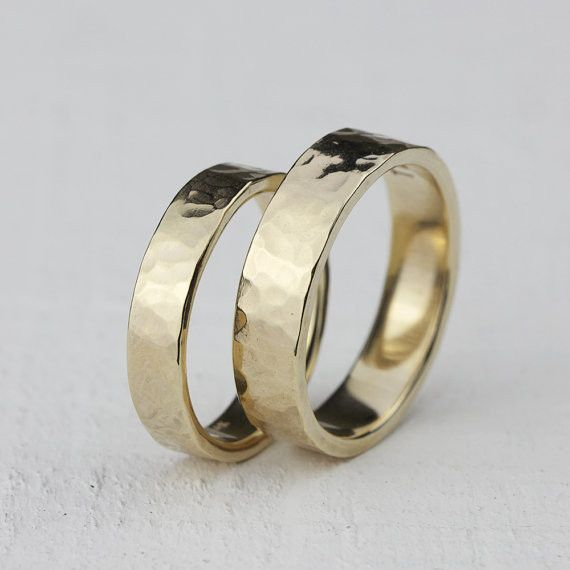 Wedding Ring Set. Hammered solid 14k gold wedding ring set shown in 14k yellow gold. This listing is for the set that has 1 wide band and 1 narrow band. The wider ring measures about 5mm high and 1.5m