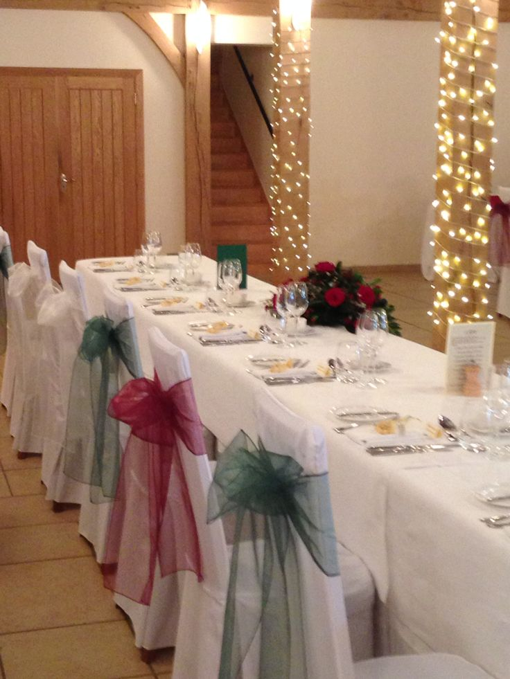 Chair covers with Emerald green and merlot sashes at Rivervale Barn. A perfect Christmas feel for any wedding or celebration by Fuschia.