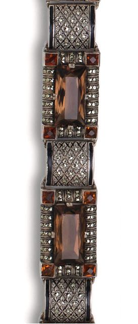 A smoky quartz, citrine, marcasite and enamel bracelet, Theodor Fahrner, circa 1926 designed as four rectangular panels, each centering a smoky quartz and bordered by marcasite and square-cut orange citrine, with arched marcasite and enamel spacers; with maker's mark TF for Theodor Fahrner; mounted in silver; length: 7 1/8in.