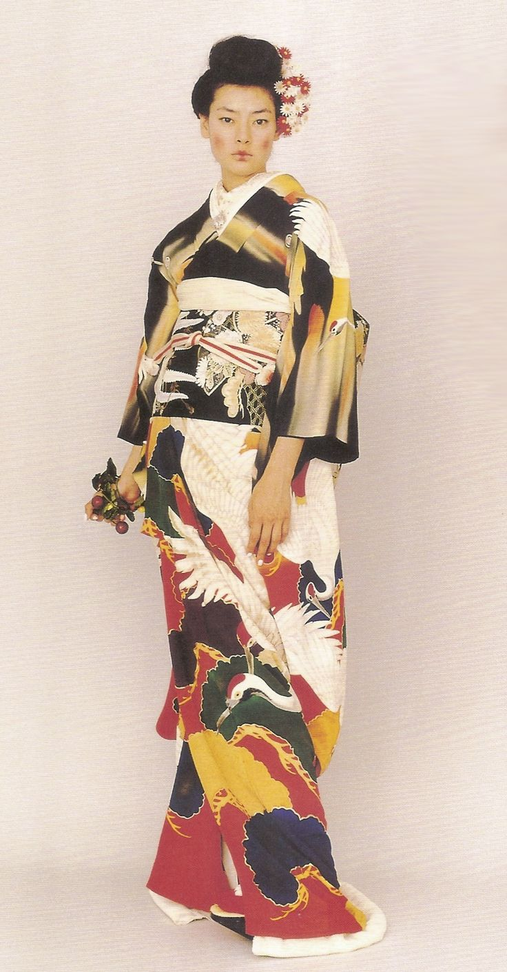 Kimono-hime issue 2. Fashion shoot page 46. Via Satomi Grim of Flickr. The luxurious kimono has large motifs of auspicious flying cranes