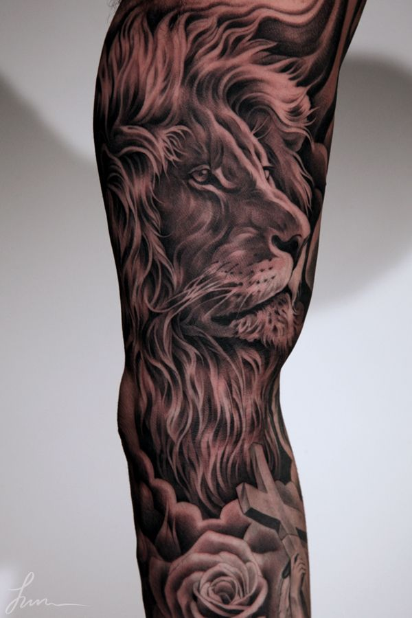 Tattoo Artist: Juncha !! Realism Lion tattoo... Ridiculously impressive Black and gray gallery. Take a look at how this Master tackles 3-dimensional statue tattoos. 3D. Roses. Grey.