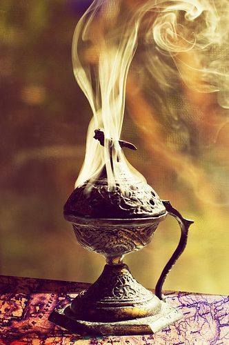 """The last pinner said: """"Censor"""" - I presume that's another word for incense. Gorgeous photo, I always love the look of smoke curling. Though the addition of having a very cool looking incense holder doesn't hurt anything."""