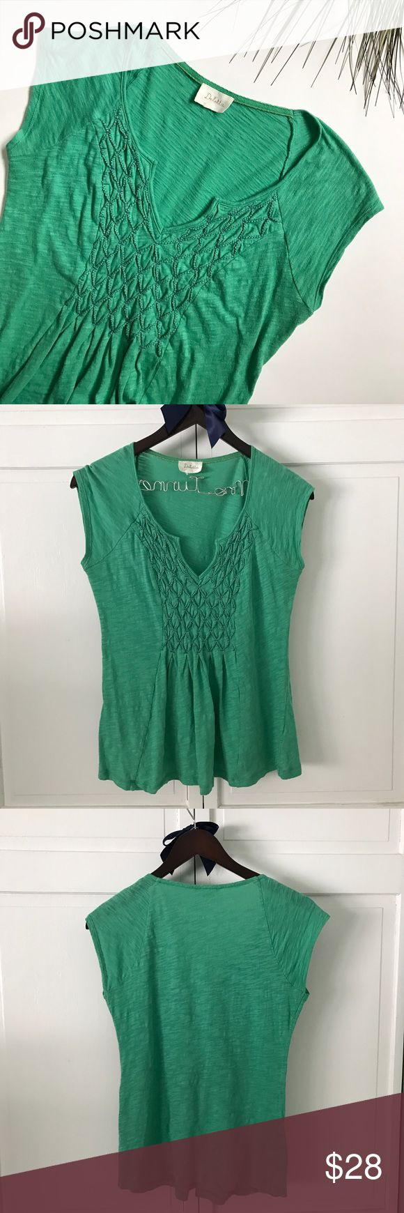 Anthropologie Top Lightweight green short sleeve top by Deletta from Anthropologie. Adorable puckered detail on chest. No size tag (from Anthropologie sample sale) but fits medium (sizes 6 & 8). In great condition, offers welcome. Anthropologie Tops