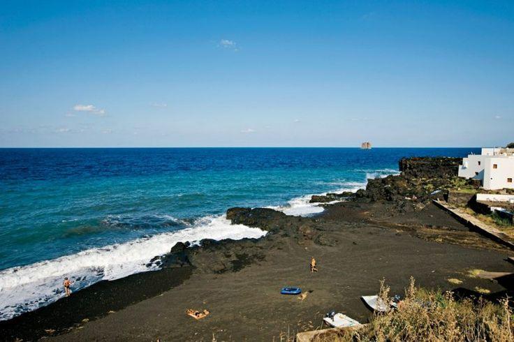 Finally, a hot spot—black sand at Piscità, on the Italian island of Stromboli.
