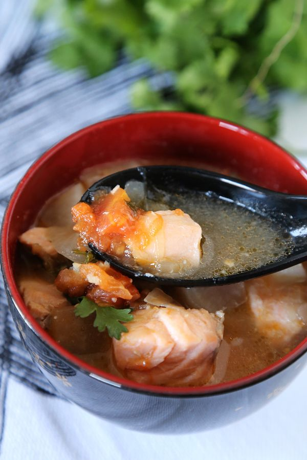 Strong flavours make this sour salmon sinigang the perfect cure for cold blues.
