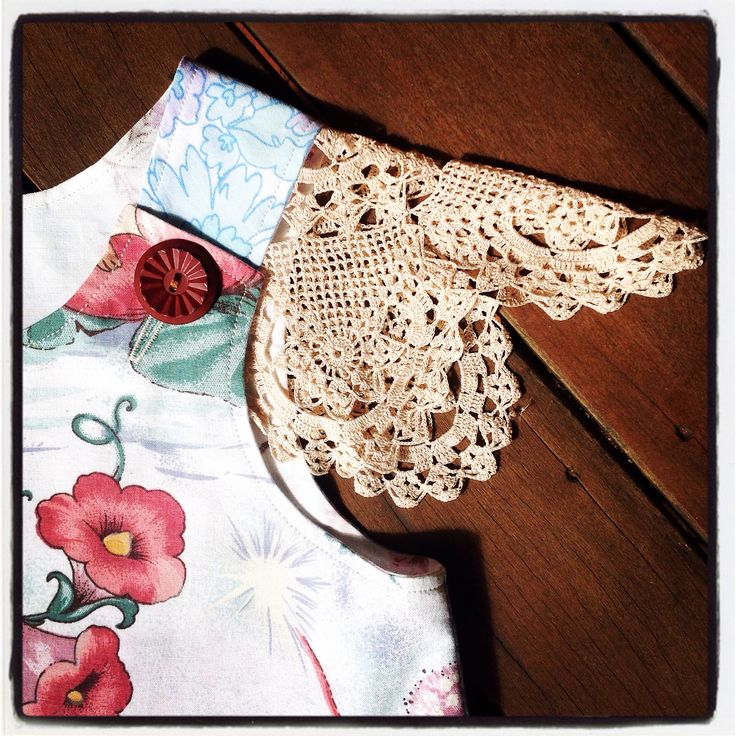 Vintage doily sleeves on this fairy pinny dress.