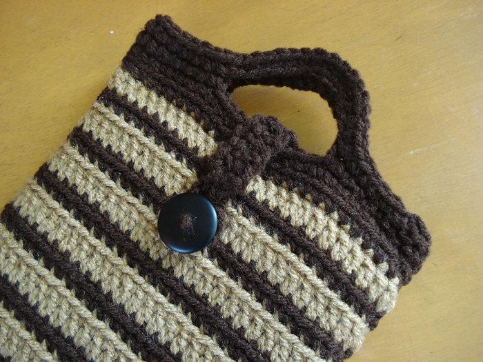 Nook Tablet or Kindle Fire, Crochet Sleeve Jacket Cover Case. $5.95, via Etsy.