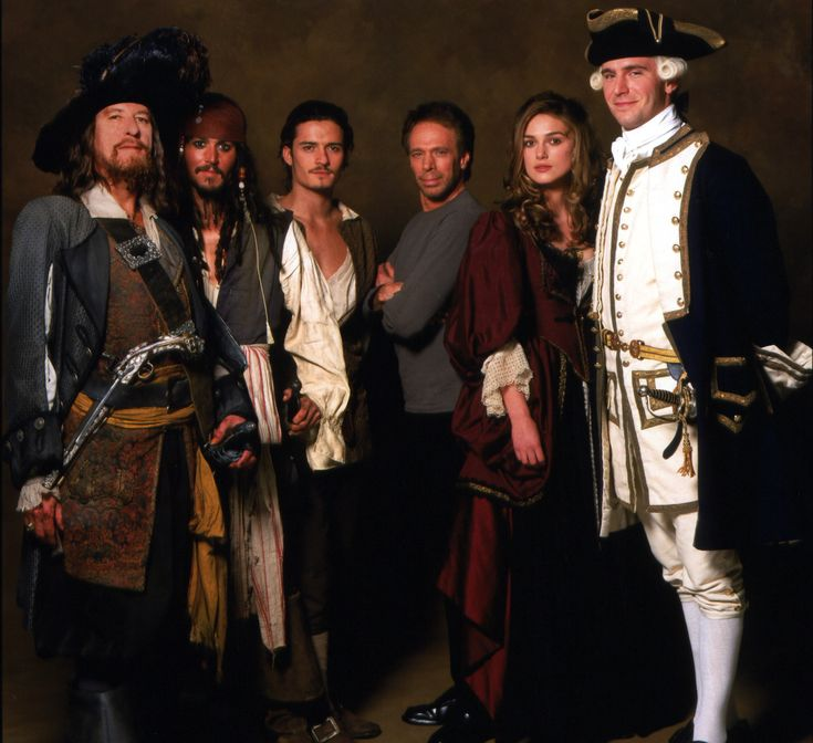 Pirates of the Caribbean cast. From left: Captain Hector Barbossa (Geoffrey Rush), Captain Jack Sparrow (Johnny Depp), Will Turner (Orlando Bloom), producer Jerry Bruckheimer, Elizabeth Swann (Keira Knightley), and James Norrington (Jack Davenport).