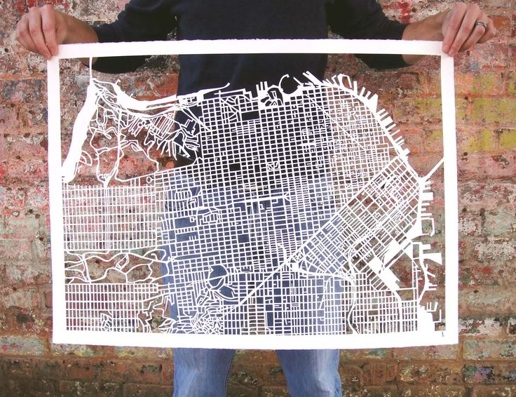 Cut paper maps...just the sort of obsessive project I'd like to do for my own beloved city.