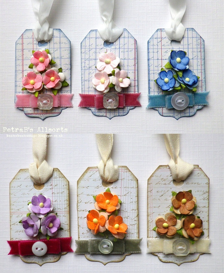 Flowery Tags. patterend paper from My Minds Eye and The Girl's paperie, stamp: PrimaMarketing, distress inks, paper flowers and velvet ribbon from the Ribbon Girl, buttons, white silky and cotton thread
