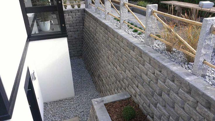 Gartengestaltung Hangsicherung und Mauerbau