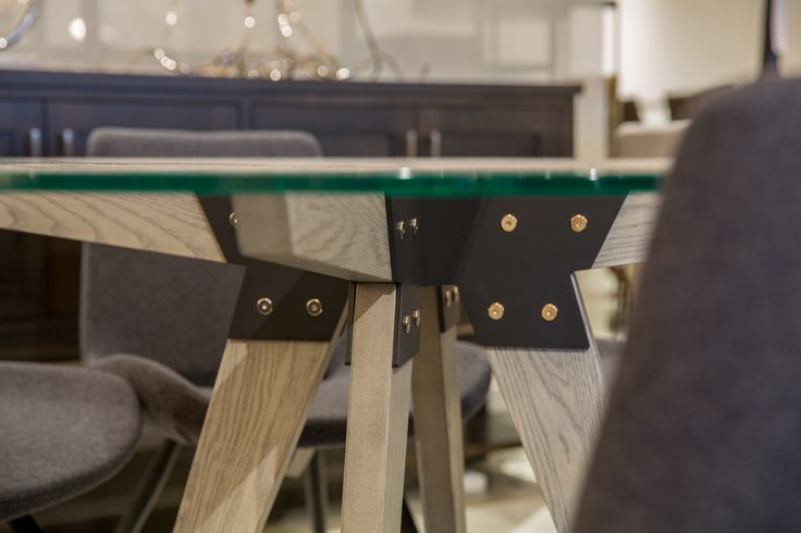 How pretty are the details on this Trica Furniture Soul dining table? The solid oak and metal legs are stunning under the glass table. Available in various finishes. #madeincanada #vancouverhomestore #diningtable