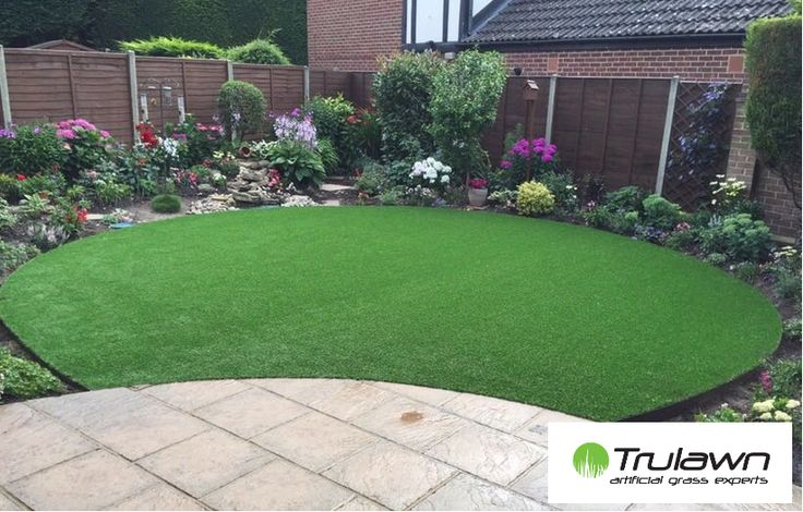 Lovely circular #artificialgrass #lawn surrounded by #flowers