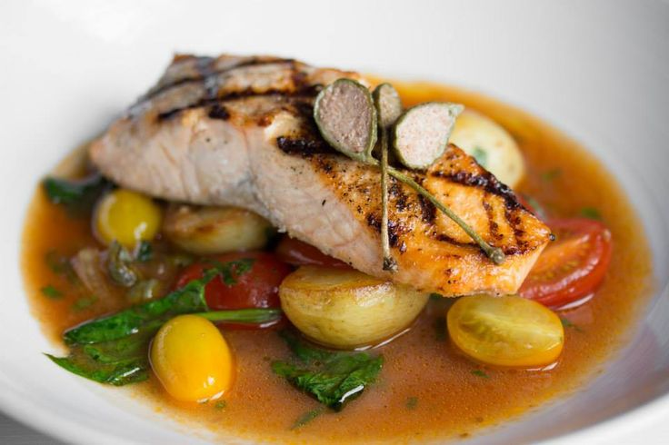 Grilled Atlantic salmon, tomato white wine broth, spinach, capers & basil #Oakville #Restaurant #Food #Italian #Cucina