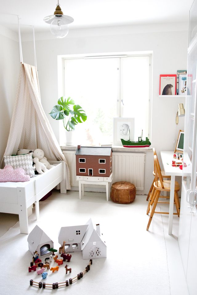 This room is so simple - white floors, walls and ceilings, the elements added make it look fun.