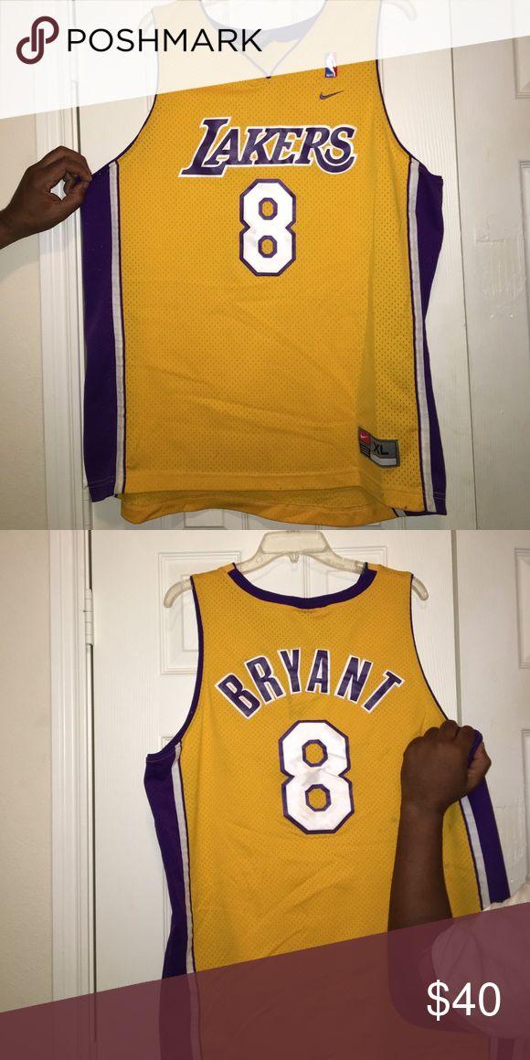 Lakers Jersey Kobe Brayant Jersey; will negotiate price, has spots. Nike Shirts Tank Tops