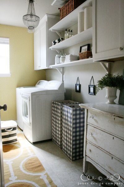 Love this laundry room makeover, especially the dresser!