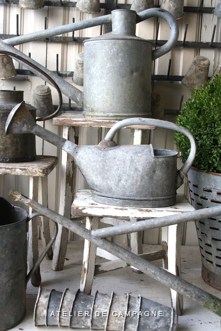 Vintage Watering Cans... from Atelier de campagne, they are located in Center Street Antiques in Soquel CA