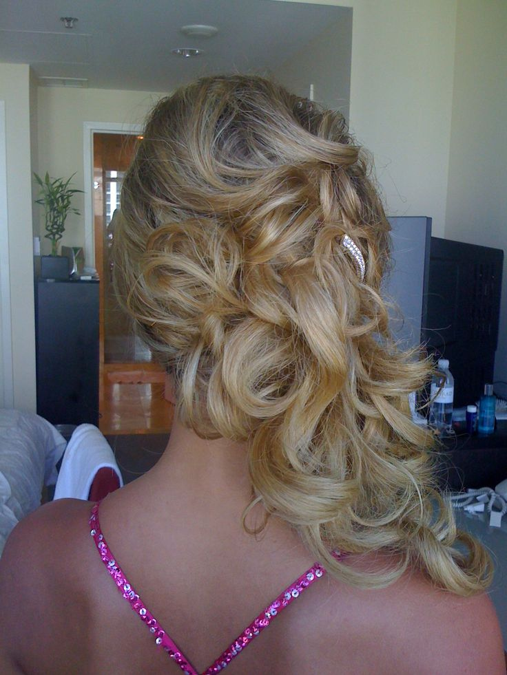 Hair to one side. This look combines the best of both and updo and down style. Hair is pulled to one side so stays neat but shows off your romantic waves. Clip-in hair extensions recommended. Artists - Hair - Ana, Makeup - Amy from South Beach Makeup Studio.