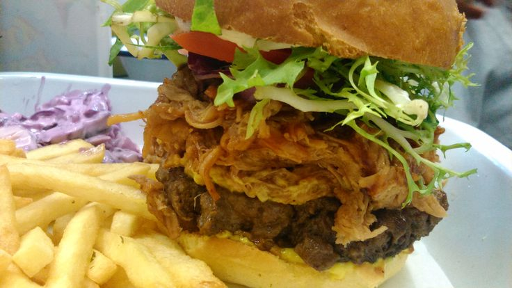 The Daddy Burger, our 100% beef burger topped with Pulled Pork & BBQ sauce.