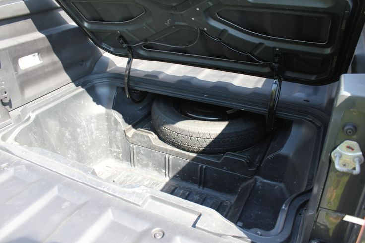 Unique to the Ridgeline is a large lockable, waterproof storage well concealed beneath the bed of the cargo box. It is easily accessed via a trap door in the floor of the box. I know several Ridgeline owners, and they find this feature to be of enormous benefit.