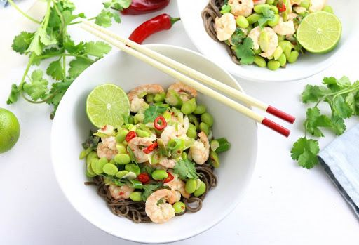 King Prawn & Edamame Stir Fry With King Prawns, Garlic, Red Chili Peppers, Edamame, Spring Onions, Soba Noodles, Coconut Oil, Fish Sauce, Tamari Soy Sauce, Lime, Coriander, Lime Wedges