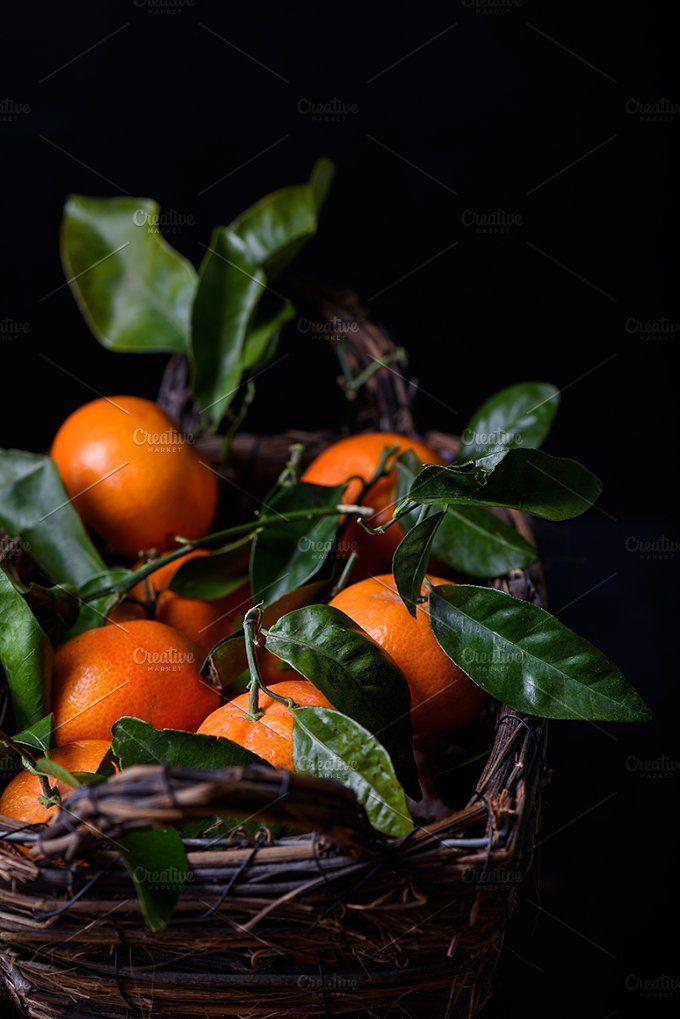 Tangerines, orange fruits by Iuliia Leonova on @creativemarket