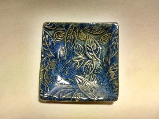 Alisa Mehmal- small square dish with leaf texture. Floating blue.