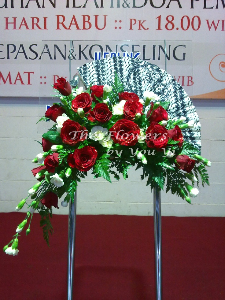 The traditional Indonesian batik-fan meets the Holland Red Grand-Gala Roses. When East meet West...
