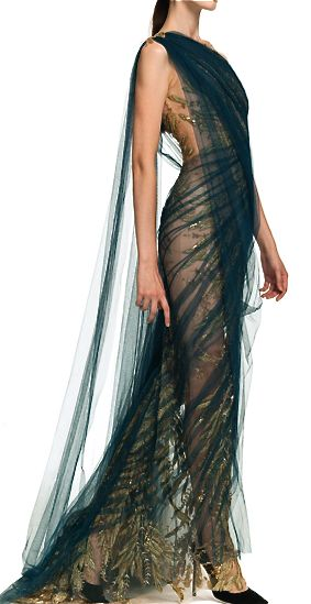 Marchesa Glown has a drape just like a saree , it has actually transformed the gown.. It looks more like a saree ... so i pinned it on this board..and i love It...great photography too