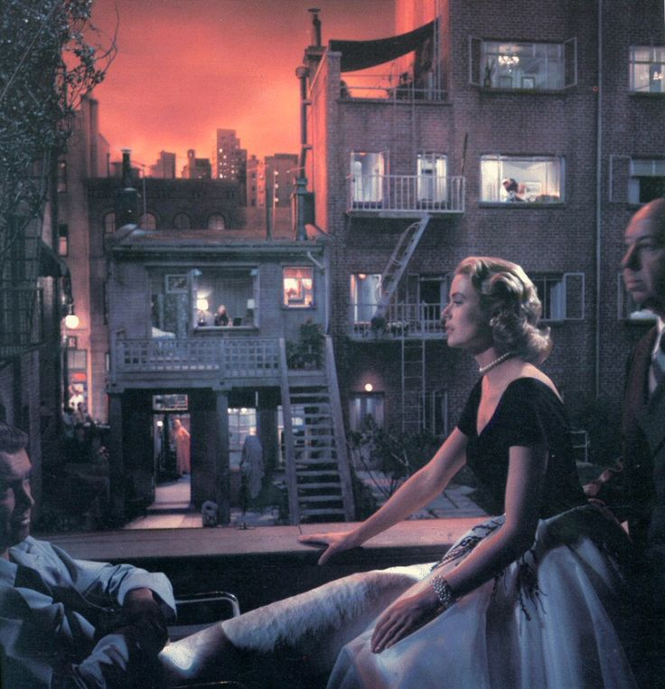 Grace Kelly, Hitchcock, and James Stewart on the set of Rear Window